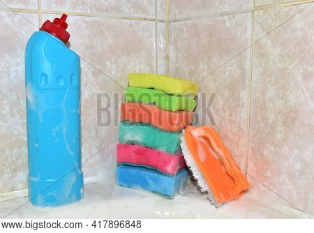 Detergent Bottle And Sponge During Cleaning Bathroom Or Toilet. Concentrated And Anti-bacterial Liqu