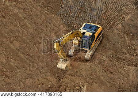 Excavator On Earthworks. Backhoe On Groundwork For Road Construction. Digger At Construction Site. L