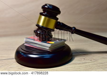 Mallet Of Judge And Bank Card In Courtroom. Litigation In The Field Of Money Theft And Fraud With Ba