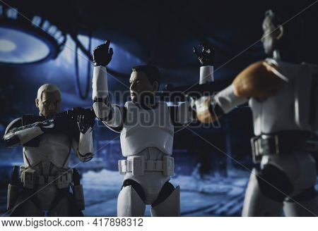 APRIL 20 2021: recreation of a scene from Star Wars The Clone Wars with clone troopers Captain Rex and Commander Cody confronting the traitor clone Slick - Hasbro action figures