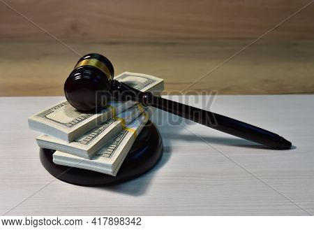 Judge Hammer And Bundles Of Dollars. Justice In Courtroom. Mallet Of Judge On Law Theme And Legal Sy