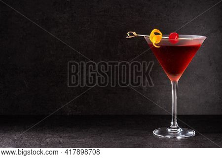 Traditional Manhattan Cocktail With Cherry On Black Background. Copy Space