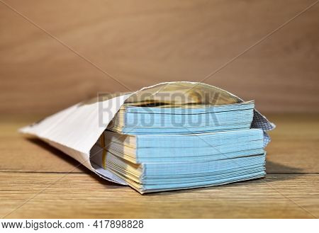 Banknotes In Paper Envelope. American Dollars In Paper Envelope. Illegal Payment Of Wages And Corrup