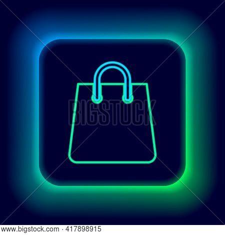 Glowing Neon Line Handbag Icon Isolated On Black Background. Shopping Bag Sign. Woman Bag Icon. Fema