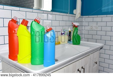 Detergent Bottles And Detergent Spray Cleaner In The Bathroom On Washbasin. Household For Cleaning A