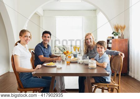 The Caucasian Family Had Breakfast Together With Parents, Daughters And Sons. Parents And Children E