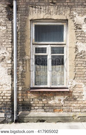 Old Ruined Building Window. Brick Wall Apartment Building Background. Post War Architecture. Broken