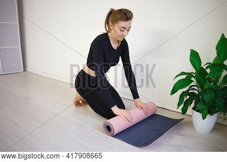Woman Unfold Yoga Mat Preparing For Practice