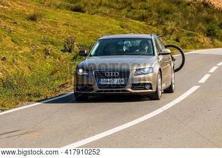 Traveling Car In Motion On Asphalt Mountain Road In Bihor, Romania, 2021