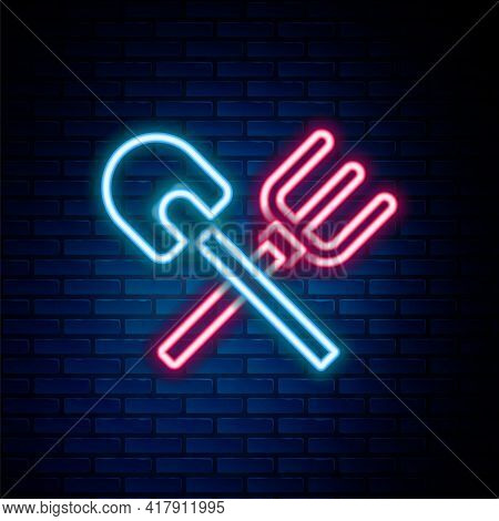 Glowing Neon Line Shovel And Rake Icon Isolated On Brick Wall Background. Tool For Horticulture, Agr