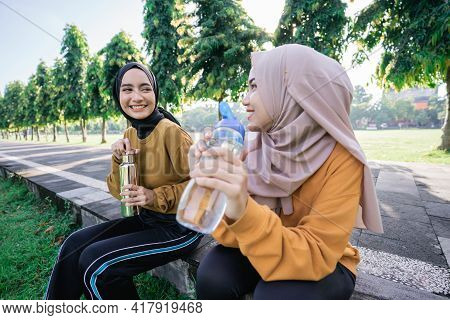 Close Up Of Two Happy Muslim Girls After Sports Together In The Afternoon When Breaking The Fast And