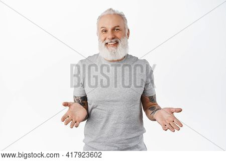 Nothing To Say. Smiling Unbothered Hipster Old Man Spread Hands Sideways, Shrugging Unaware, Look Ca