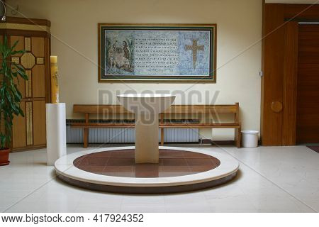 ZAGREB, CROATIA - SEPTEMBER 03, 2014: Baptismal font in the parish church of St. Matthew in Dugave, Zagreb, Croatia
