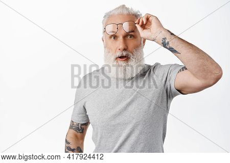 Surprised Mature Guy With Long Beard, Take-off Glasses And Look In Awe, Staring At Something Amazing