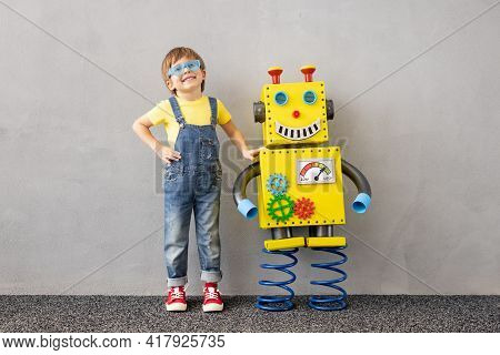 Happy Child With Toy Robot