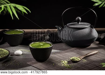 Matcha Tea Powder And Tea Accessories On Dark Background. Tea Ceremony. Traditional Japanese Drink.