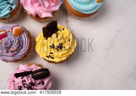 Delicious Homemade Cupcakes With Colorful Cream And Topping With Candy And Chocolate Cookies. Homema