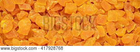 background and texture of dried mango fruit diced, panoramic web banner