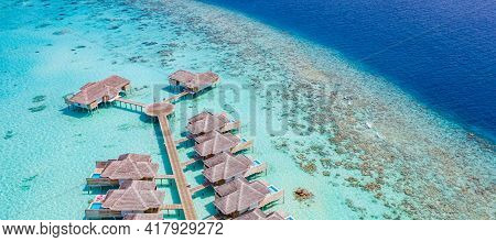 Perfect Aerial Landscape, Luxury Tropical Resort Or Hotel With Water Villas And Beautiful Turquoise
