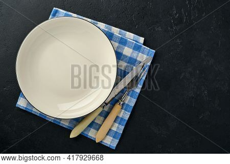 Kitchen Table With Empty Plate White Color, Blue Tablecloth And Space For Your Recipe Or Menu. Top V