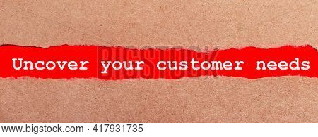 A Strip Of Red Paper Under The Torn Brown Paper. White Lettering On Red Paper Uncover Your Customer