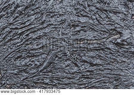 Black Bitumen Abstract Dark Pattern Texture Background, Industrial Oil Refinery Waste.