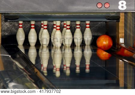 The Fall Of The Ball Into The Gutter Close To The Pins. Unsuccessful Throw. Lack Of Precision In The