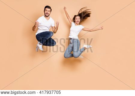 Full Body Photo Of Young Excited Couple Happy Positive Smile Active Jump Up Wear Denim Isolated Over