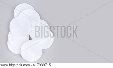 Heap Of White Soft Cleansing Cotton Pads Or Discs On Gray Table Top View With Copy Space