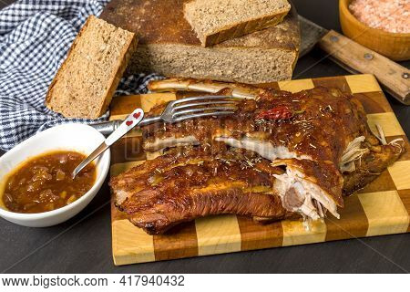 Grilled Pork Ribs With Honea And Chili. Roasted Meat On The Kitchen Board. Preparation Of Marinade F