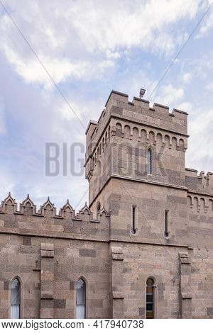 The Walls And Towers Of The Old Palace On The Background Of A Cloudy Sky