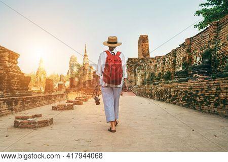 Young Woman Tourist Walking With Compact Photo Camera Through Ayutthaya Wat Phra Ram Ancient Ruins I