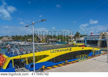 Isla Mujeres - March 13.2021: View Of The Ferry Port With The Boat Ultramar In Isla Mujeres, Cancun,
