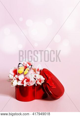 Heart Shape Gift Box And Bouquet With Butterfly On Pink Background.