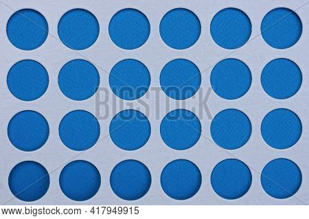 White Sheet Paper Texture With Rows Of Blue Circular Holes
