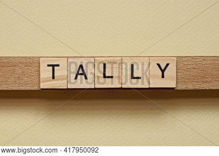 Gray Word Tally Made Of Wooden Square Letters On Brown Background