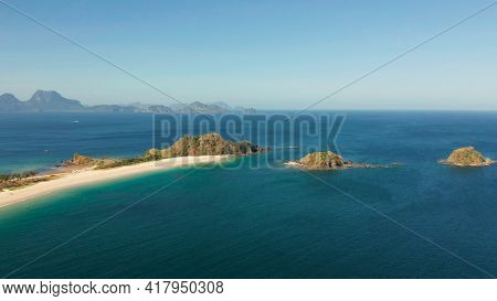 Tropical Island With Sandy Beach, Aerial View. Nacpan, El Nido, Palawan, Philippine Islands. Seascap