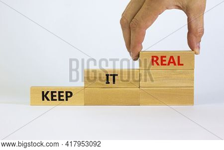 Keep It Real Symbol. Businessman Placing A Blocks With Word 'keep' On Top Of A Blocks Tower With Wor