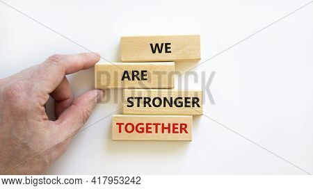 Stronger Together Symbol. Wooden Block With Words 'we Are Stronger Together'. Beautiful White Backgr