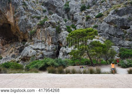 Spain, Mallorca, July 2019. Beautiful Beach, Rocky Mountains In The Gorge And Bay Of Sa Calobra, Spa