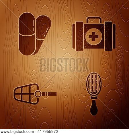 Set Hair Brush For Dog And Cat, Dog And Pills, Dog Muzzle And Pet First Aid Kit On Wooden Background
