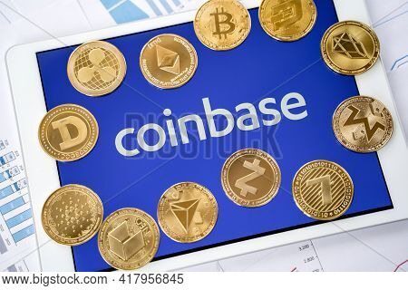 Russia Moscow 29.03.2021 Tablet With Logo Of Cryptocurrency Exchange Coinbase. Crypto Coins Company,