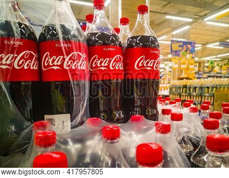 Plastic Two-liter Bottles Of Coca-cola Drink Are Sold In Bulk In The Hypermarket 11.04. 2021 In Russ
