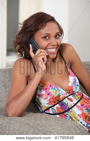 Young woman smiling on the phone