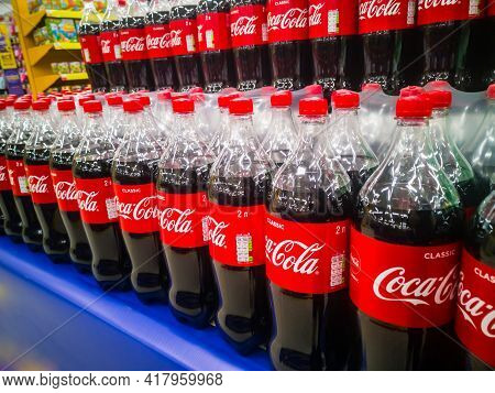 Plastic Two-liter Bottles Of Coca-cola Carbonated Drink Are Sold In Bulk In The Hypermarket 11.04. 2