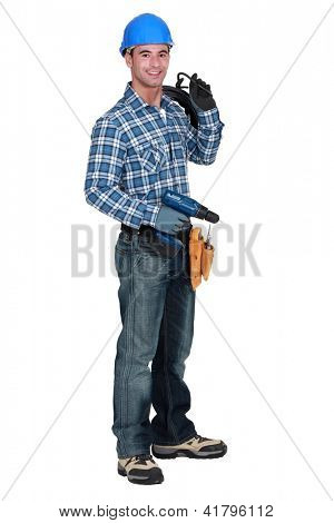 A man holding a driller.