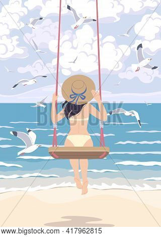 Young Woman In Straw Hat Swinging On Swing At The Sea Coast. Girl In Swimsuit Back View. Vacation Co
