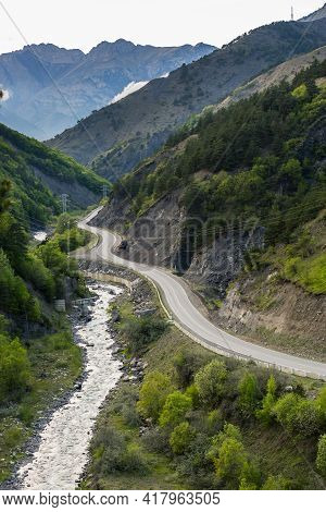 Asphalt Road Along The River. Valley In The Caucasus Mountains. Serpentine Road In Ingushetia, Russi