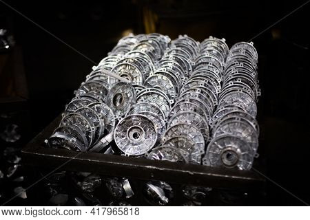 Aluminum Workpieces Of Electric Motors In Dirty Container At Outdated Factory