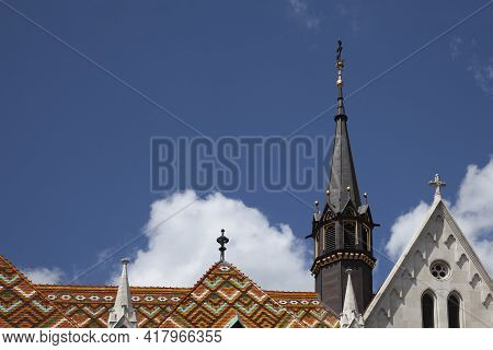 Scenic Roof And Spire Of St. Matthias Cathedral In Budapest, Hungary.